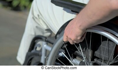 Close up of disabled man using wheelchair - Life is running...