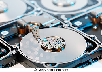 close up of disassembled hard disk with abstract reflection.