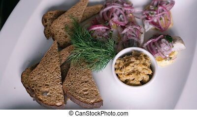 Close up of dish of toasts with onion rotates on the plate