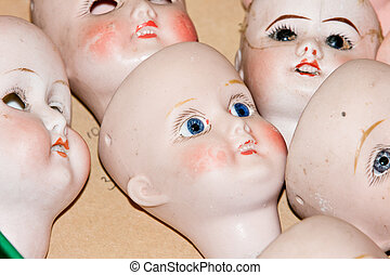 Close up of doll heads
