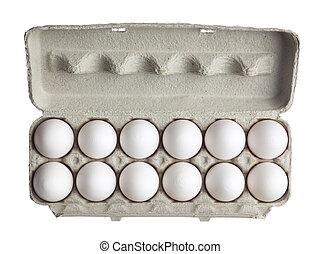 dozen of eggs in carton box - Close-up of dozen of eggs in...