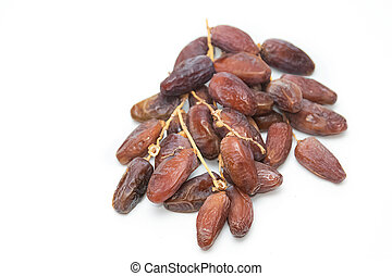close up of dried dates on white ba