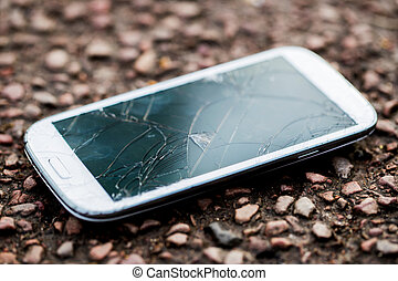 Close Up Of Dropped Mobile Phone With Cracked Screen