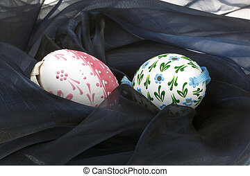 Close-up of Easter eggs on black velvet