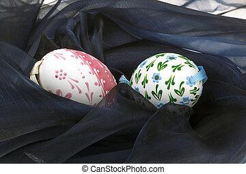 Close-up of Easter eggs on black velvet