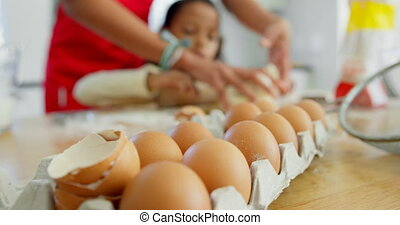 Close-up of egg tray on kitchen worktop at home 4k - Close-...