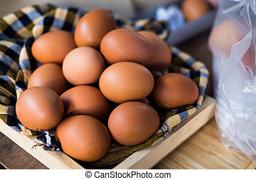 Close up of eggs in wooden box