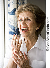 Close up of elderly woman laughing