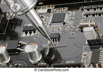 Close up of electronic circuit board with several ...