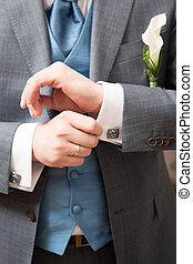 Close-up of elegance groom hands