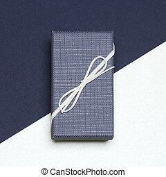 Close-up of elegantly wrapped gift for man
