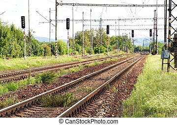 Close up of empty straight railroad track in Czech Republic. Perspective view. Railroad tracks with concrete sleepers.