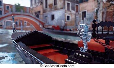 Close-up of empty venetian gondola on Venice canal -...
