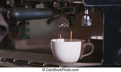 Close-up of Espresso Pouring from Coffee Machine - Close-up...