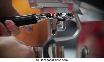 Close up of espresso pouring from coffee machine. Slow...
