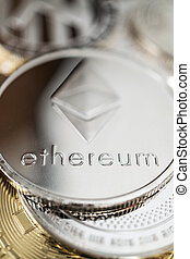 Close-up of ether physical coin on stack of many other ...