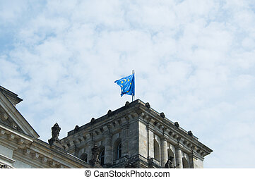 Close-up of European flag on famous Reichstag building, seat of the German Parliament (Deutscher Bundestag), travel in Berlin