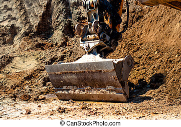 close-up of excavator in stand by on construction site