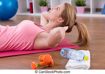Close-up of exercising woman