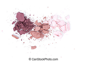 Close up of eye shadow scattered on a white isolated background