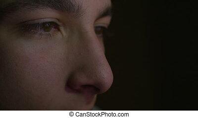 Close-up of eyes looking at tablet