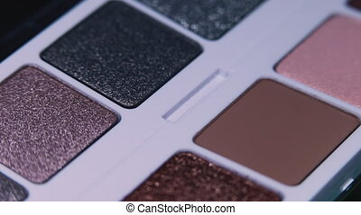 Close up of eyeshadows colorful palette - cosmetics for eyes. Beauty advertising , make-up artist instruments concept. Macro detailed footage. High quality 4k footage
