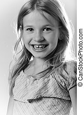 eight year old - close up of face of a cute little blond...