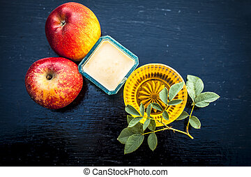 Close up of face pack of apple i.e. apple pulp mixed with honey to normalize skin which becomes dry in winter on wooden surface.;