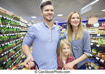 Close up of family in supermarket