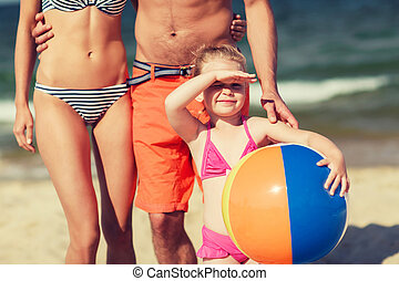 close up of family with inflatable ball on beach
