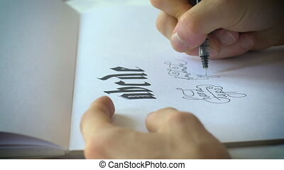 Close up of fancy handwriting using a pen and paper - A...