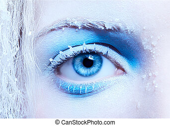 close-up portrait of beautiful girl's eye-zone fantasy snow make-up