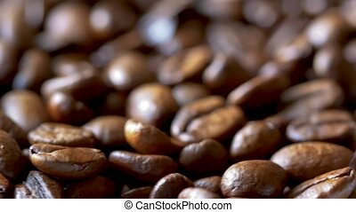 Close-up of Fast Rotating Roasted Coffee Beans, Blurry...