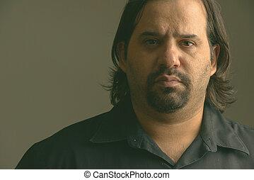 Close up of fat Caucasian man in the dark