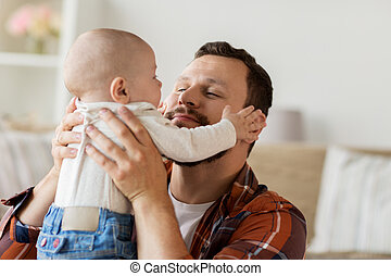close up of father with little baby boy at home