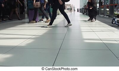 Close up of feet of unrecognizable people with baggages walking in terminal airport. slow motion. 3840x2160