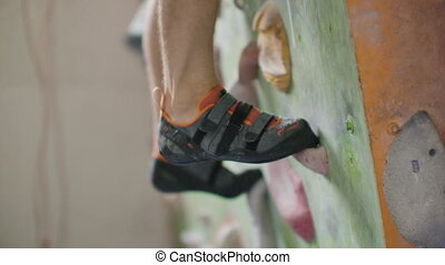 Close-Up Of Feet Shod In Shoes For Rock Climbing Overcome...