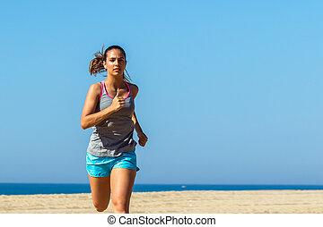 Close up of female athlete jogging.