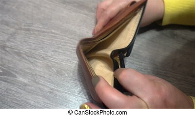 Close up of female businessman's hands showing empty wallet....