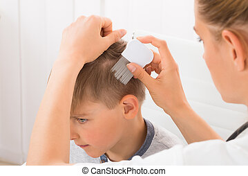 Doctor Doing Treatment On Boy's Hair