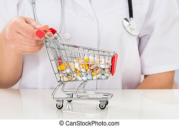 Doctor With Shopping Cart Full Of Pills