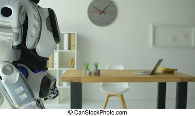 Close up of female employee and robot shaking hands in office