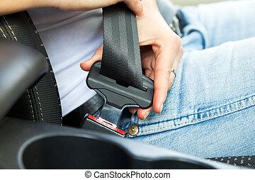 safety belt - close up of female fastening safety belt in ...