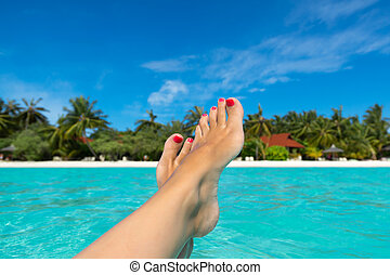 Close-up of female foot in the sea - Close-up of female foot...