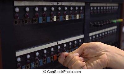 Close-up of female hand using 30-line teleprinter...