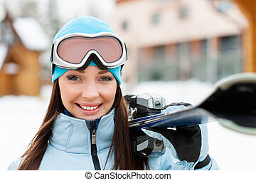 Close up of female handing skis