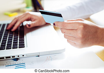 Close up of female hands making on line payment
