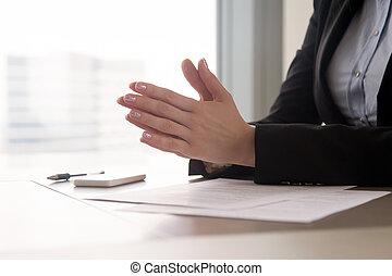 Close up of female hands put together, concentration or nerves