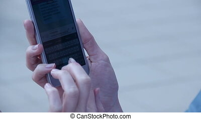 """""""Close-up of female hands typing text, message on touchscreen"""""""