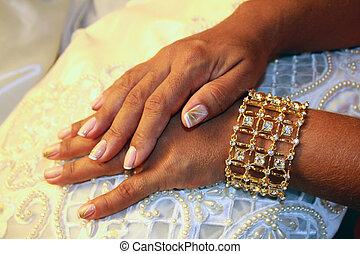 bracelet - Close up of female hands with bracelet